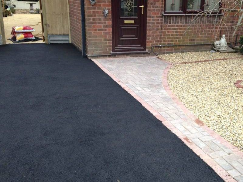 tarmac driveways in Hinckley carried out last year - image shows new driveway we laid next to a block paved pathway and small front garden