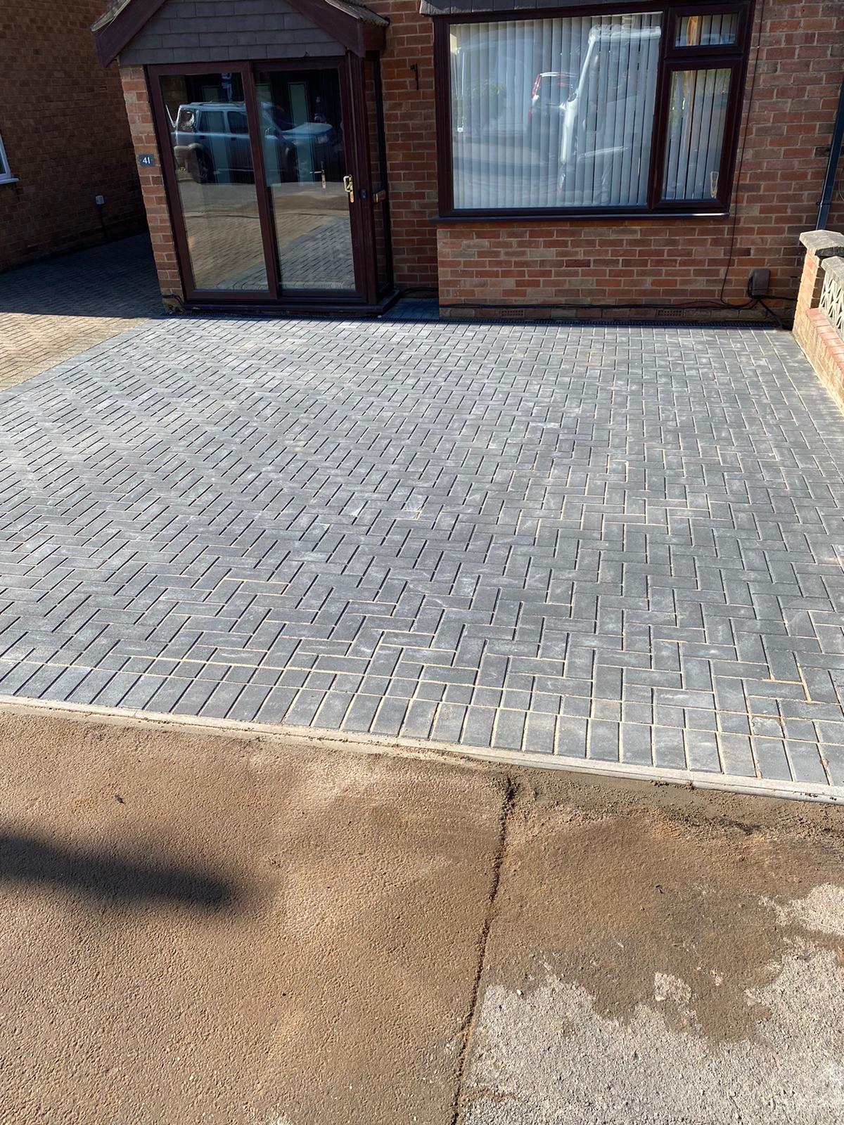 Block paving driveway completed with edge stones and dropped kerb