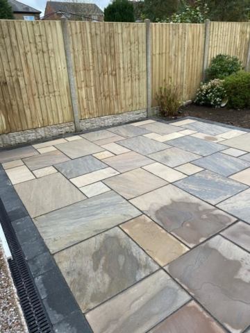 Completed Landscaping project with paving flags and new drainage channels