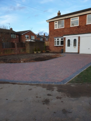 Large driveway project completed in bedworth using two colours and dropped kerb