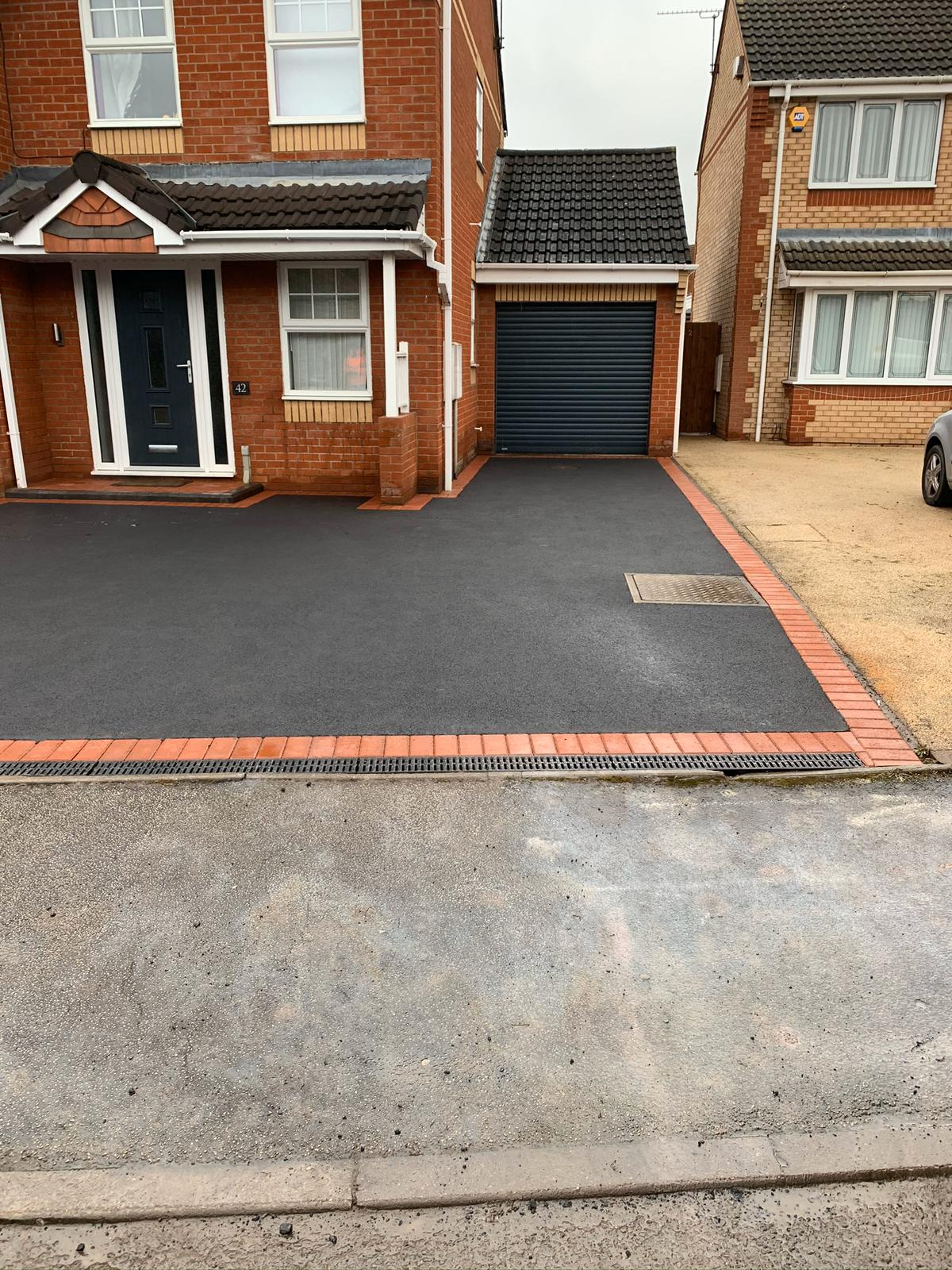 Driveway project completed in coventry including sealed edges and new drainage