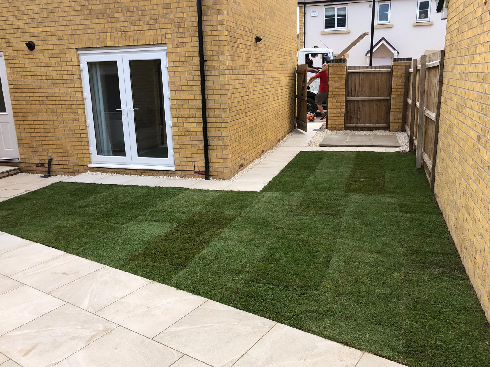 Newly landscaped garden project including limestone flags and new turf