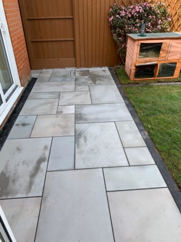 Recently laid patio with black brick edges